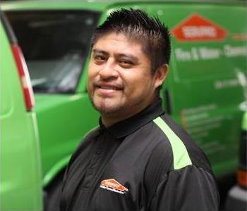 Male SERVPRO Technician with equipment as background