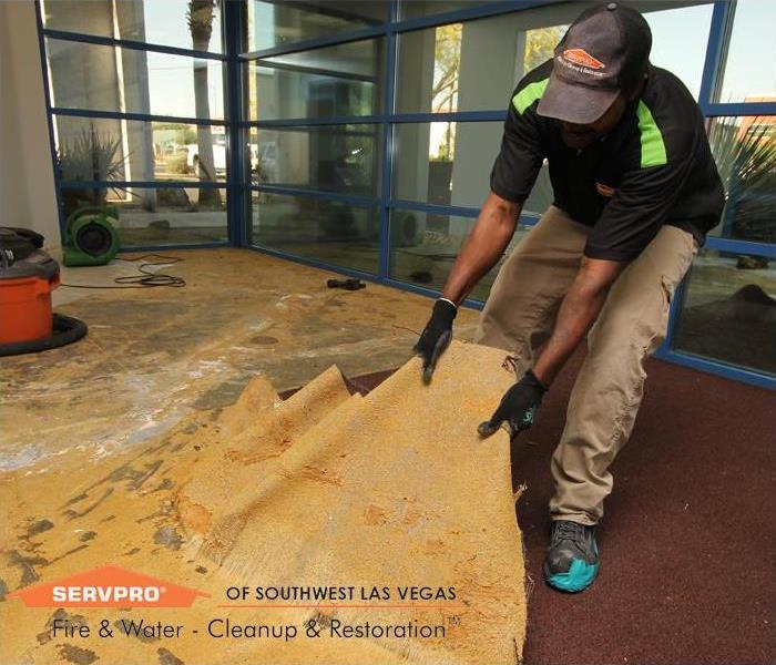 Commercial Glue down commercial carpet, water damage Las Vegas